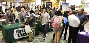 Photo - Students talk with recruiters during Oklahoma City Community College's annual job fair. Retailers and other companies are ramping up holiday hiring. <strong>PAUL B. SOUTHERLAND - PAUL B. SOUTHERLAND</strong>