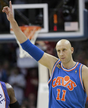 Photo - FILE - In this Dec. 2, 2009, file photo, Cleveland Cavaliers' Zydrunas Ilgauskas, of Lithuania, acknowledges the crowd while entering an NBA basketball game against the Phoenix Suns in Cleveland. Ilgauskas, a gentle giant who connected with Cleveland fans and became one of the city's most beloved athletes, will have his No. 11 jersey retired during halftime ceremonies Saturday, March 8, 2014, by the Cavaliers. (AP Photo/Tony Dejak, File)