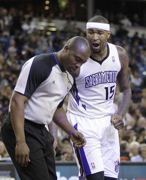 Photo - Sacramento Kings center DeMarcus Cousins questions official Courtney Kirkland after he was called for a foul during the first quarter of an NBA basketball game in Sacramento, Calif., Tuesday Feb. 25, 2014.  Cousin picked up two technical fouls and was ejected in the third quarter of the Rockets 129-103 win over the Kings(AP Photo/Rich Pedroncelli)