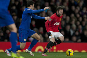 Photo - Manchester United's Juan Mata, right, keeps the ball from Cardiff City's Peter Whittingham during their English Premier League soccer match at Old Trafford Stadium, Manchester, England, Tuesday Jan. 28, 2014. (AP Photo/Jon Super)