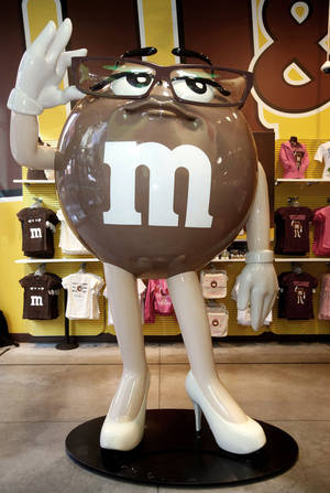 Photo - A 10-foot statue of the latest M&M'S character, Ms. Brown, is unveiled at the M&M'S World Store in New York.  AP Photo
