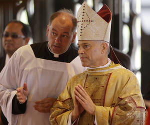 Photo -   Salvatore J. Cordileone, right, waits to be introduced during a ceremony to install him as the new archbishop of San Francisco at the Cathedral of St. Mary of the Assumption in San Francisco, Thursday, Oct. 4, 2012. (AP Photo/Marcio Jose Sanchez, Pool)