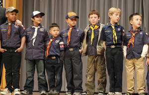 "Photo - Cub Scouts from Pack 543 appear on stage at the Boy Scouts of America annual fundraising ""Character Counts"" breakfast this month. Photo by David McDaniel, The Oklahoman"