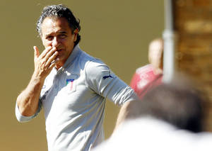 Photo - Italy coach Cesare Prandelli arrives for a training session at the Coverciano sports center, near Florence, Italy, Wednesday Sept. 4, 2013 ahead of  2014 World Cup Group B qualifying soccer match between Italy and Bulgaria scheduled for Friday Sept. 6 in Palermo. (AP Photo/Fabrizio Giovannozzi)