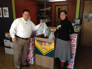 Photo -  Comtech employee Doug McClure and Heather Cannon with Caliber Roofing donate supplies to the Team Up OKC school supply drive to benefit The Foundation for Oklahoma City Public Schools. The school supply drive ends Monday. PHOTO PROVIDED  <strong></strong>