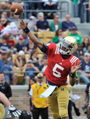 Photo - Notre Dame quarterback Everett Golson throws a pass during the second half of Notre Dame's spring NCAA college football game Saturday April 12, 2014 in South Bend, Ind. The Blue Gold game marks the end of spring football practice. (AP Photo/Joe Raymond)