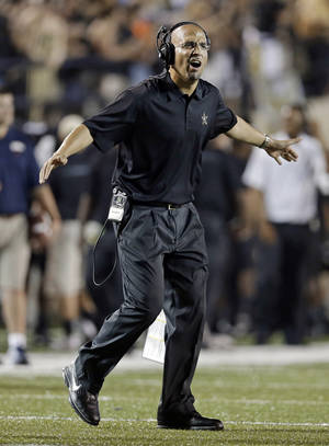 Photo - Vanderbilt head coach James Franklin reacts to a play against Mississippi in the second quarter of an NCAA college football game on Thursday, Aug. 29, 2013, in Nashville, Tenn. (AP Photo/Mark Humphrey)