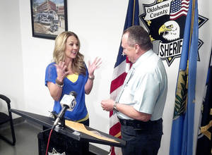 Photo - Oklahoma County Sheriff John Whetsel returns a wedding ring to Julie Riggins.  Photo provided by Oklahoma County Sheriff's office