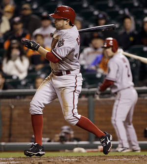 Photo - Arizona Diamondbacks' Tony Campana drives in a run with a single against the San Francisco Giants during the 10th inning of a baseball game on Thursday, April 10, 2014, in San Francisco.  Arizona won 6-5. (AP Photo/Marcio Jose Sanchez)