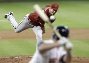 Photo - Arizona Diamondbacks' Brandon McCarthy delivers a pitch to Houston Astros' Matt Dominguez in the first inning of a baseball game Wednesday, June 11, 2014, in Houston. (AP Photo/Pat Sullivan)