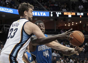 Photo -   Orlando Magic center Jerome Jordan (44) is fouled by Memphis Grizzlies center Marc Gasol (33), of Spain, during the first half of an NBA basketball preseason game Wednesday, Oct. 24, 2012, in Memphis, Tenn. (AP Photo/Lance Murphey)