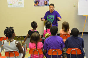 Photo - Teacher Spring Bruins instructs a group of children as part of a Reaching Our City community program.  Photo provided <strong></strong>