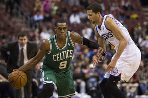Photo - Boston Celtics' Rajon Rondo, left, looks to make his move on Philadelphia 76ers' Michael Carter-Williams, right during the second half of an NBA basketball game, Wednesday, Feb. 5, 2014, in Philadelphia. The Celtics won 114-108. (AP Photo/Chris Szagola)