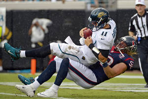 photo -   Jacksonville Jaguars quarterback Blaine Gabbert (11) is sacked by Houston Texans outside linebacker Brooks Reed (58) during the first half of an NFL football game, Sunday, Sept. 16, 2012, in Jacksonville, Fla. (AP Photo/Phelan M. Ebenhack)