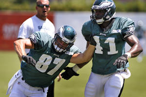 Photo - Philadelphia Eagles tight ends Brent Celek (87) and Emil Iqwenaqu (41) take part NFL football training camp, Monday July 29, 2013, in Philadelphia. (AP Photo/ Joseph Kaczmarek)