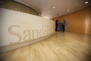 photo - A SandRidge Energy sign is shown during a tour of the headquarters June 22 in Oklahoma City.  Photo by Garett Fisbeck, The Oklahoman