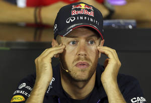 Photo - Red Bull driver Sebastian Vettel of Germany touches his temples during a news conference at the Catalunya racetrack in Montmelo, near Barcelona, Spain, Thursday, May 8, 2014. The Formula One race will be held on Sunday. (AP Photo/Luca Bruno)