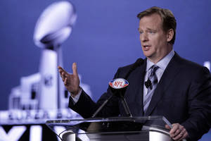 Photo -   NFL Commissioner Roger Goodell answers a question during a news conference Friday, Feb. 3, 2012, in Indianapolis. The New England Patriots will face the New York Giants in Super Bowl XLVI on Feb. 5. (AP Photo/David J. Phillip)