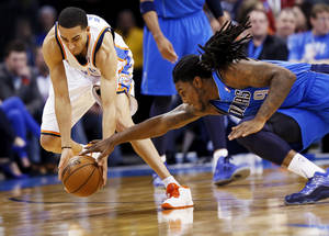 Photo - Oklahoma City's Kevin Martin (23) steals the ball from Dallas' Jae Crowder (9) during an NBA basketball game between the Oklahoma City Thunder and the Dallas Mavericks at Chesapeake Energy Arena in Oklahoma City, Monday, Feb. 4, 2013. Photo by Nate Billings, The Oklahoman