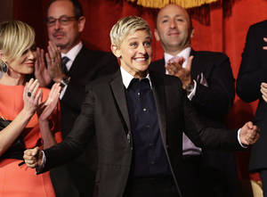 photo - FILE - In this Oct. 22, 2012 file photo, Ellen DeGeneres reacts as she is introduced, with wife Portia de Rossi, left, before DeGeneres receives the 15th annual Mark Twain Prize for American Humor at the Kennedy Center in Washington. The talk show host is visiting Sydney and Melbourne on her six-day trip to the country for segments being filmed for her popular U.S. television show. (AP Photo/Alex Brandon, File)