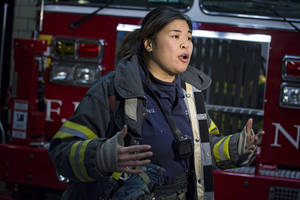 Photo - New York City firefighter Sarinya Srisakul speaks about her work in the FDNY Tuesday, Jan. 28, 2014, at a Manhattan fire house. Srisakul, who didn't work with another woman for five years, took pictures when she did because it was such a rarity. In the nation's largest fire department, out of more than 10,500 uniformed firefighters, only 37 are women, one of the lowest percentages of any big-city department. That number is expected to grow after a record number of women took the latest exam following heavy recruitment spurred by a landmark court order three years ago, but advocates say more needs to be done.  (AP Photo/Craig Ruttle)