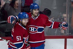 Photo - Montreal Canadiens' Max Pacioretty, right, celebrates his goal against the Phoenix Coyotes with teammate David Desharnais during the third period of an NHL hockey game Tuesday, Dec. 17, 2013, in Montreal. Montreal won 3-1. (AP Photo/The Canadian Press, Paul Chiasson)