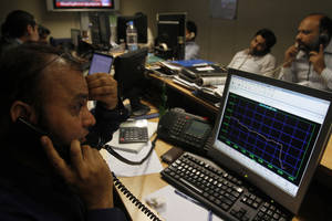 Photo - FILE - In this  Tuesday, Jan. 15, 2013, file photo, Pakistani stock brokers monitor a market at the Karachi Stock Exchange in Karachi, Pakistan. The success of so-called frontier markets, a group mostly in Africa and the Middle East, is starting to attract U.S. investors eager to find the next hot area.  Thanks to rapid economic growth, the MSCI Frontier Market index has gained 22 percent over the past year. That compares with 3 percent growth for MSCI's emerging market index (AP Photo/Shakil Adil, File)