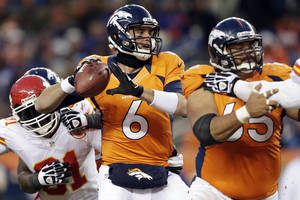 photo - FILE - In this Dec. 30, 2012, file photo, Denver Broncos quarterback Brock Osweiler (6) sets to throw a pass in the fourth quarter of an NFL football game against the Kansas City Chiefs in Denver. All eyes were on Broncos starting quarterback Peyton Manning this season, especially Osweiler's. If, heaven forbid, something should happen to the four-time MVP in the playoffs, the next man up is the four-time passer, a rookie from Arizona State who's biding his time much like Green Bay Packers quarterback Aaron Rodgers did with Brett Favre. (AP Photo/Joe Mahoney, File)