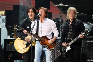 Photo - This image released by Starpix shows Paul McCartney, center, at the 12-12-12 The Concert for Sandy Relief at Madison Square Garden in New York on Wednesday, Dec. 12, 2012. Proceeds from the show will be distributed through the Robin Hood Foundation. (AP Photo/Starpix, Dave Allocca)