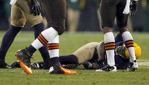 Photo - Green Bay Packers' Jermichael Finley lays on the field after being injured during the second half of an NFL football game against the Cleveland Browns Sunday, Oct. 20, 2013, in Green Bay, Wis. Finley left the game on a stretcher. (AP Photo/Mike Roemer)