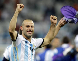 Photo - Argentina's Javier Mascherano celebrates after Argentina defeated the Netherlands 4-2 in a penalty shootout after a 0-0 tie after extra time to advance to the finals during the World Cup semifinal soccer match between the Netherlands and Argentina at the Itaquerao Stadium in Sao Paulo Brazil, Wednesday, July 9, 2014. (AP Photo/Victor R. Caivano)