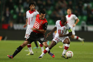 Photo -   French midfielder Rio Mavuba of Lille challenges for the ball with Rennes' forward Julien Feret during their french League One soccer match in Rennes, western France, Friday, Sept. 28, 2012. (AP Photo/David Vincent)