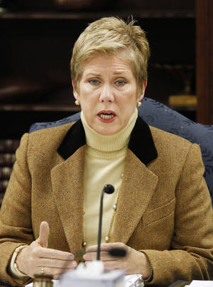 photo - State schools Superintendent Janet Barresi talks about security and safety in schools at the beginning of a state Board of Education meeting in Oklahoma City Wednesday, Dec. 19, 2012. Barresi is asking school boards across Oklahoma to double-check safety procedures in light of the Connecticut school massacre. Photo by Paul B. Southerland, The Oklahoman