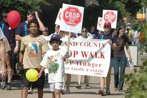 Photo - People participate in a previous Cleveland County CROP Walk to Stop Hunger in Norman. The 2012 walk will be Sunday, with registration to begin at 1:30 p.m. at Food & Shelter Inc., 104 W Comanche in Norman. Photo by David Wheelock