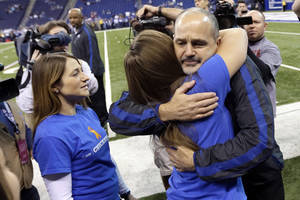 photo - Indianapolis Colts head coach Chuck Pagano is greeted by family members after walking onto the field before an NFL football game against the Houston Texans, Sunday, Dec. 30, 2012, in Indianapolis. Pagano is back as coach after nearly three months of treatments for leukemia. (AP Photo/AJ Mast)