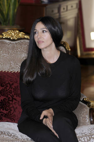 Photo - Italian actress Monica Bellucci , during a meeting with the President of the Republic of Srpska Milorad Dodik , during a visit to Bosnian town of Banja Luka, 240 kms northwest of Sarajevo, Bosnia, on Saturday, Jan. 19, 2013. (AP Photo/Radivoje Pavicic )
