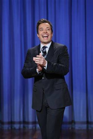 "Photo - This April 4, 2013 photo released by NBC shows Jimmy Fallon, host of ""Late Night with Jimmy Fallon,"" in New York. The role of female talk-show hosts in late-night TV network history, all 50-plus years of it, can be summed up in two words: Joan Rivers. It takes just another two _ Arsenio Hall _ to do the same for minorities. There's no indication that's going to change in the latest round of musical chairs involving ""Tonight"" and ""Late Night."" (AP Photo/NBC, Lloyd Bishop)"