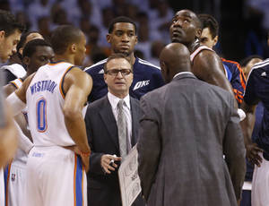 Photo - Oklahoma City Thunder coach Scott Brooks talks to his team in the first quarter of Game 5 of the Western Conference semifinal NBA basketball playoff series against the Los Angeles Clippers, in Oklahoma City on Tuesday, May 13, 2014. (AP Photo)