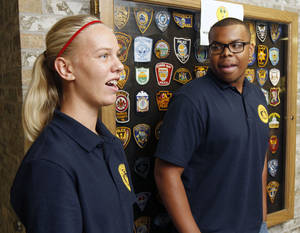 Photo - Students Bailey Harper and Christopher Plunkett  discuss their experiences as they and other students take part in the Oklahoma City Student Police Academy. Photo by Paul Hellstern, The Oklahoman <strong>PAUL HELLSTERN - Oklahoman</strong>