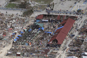 Photo - An aerial image taken from a Philippine Air Force helicopter shows the devastation caused by typhoon Haiyan in Guiuan,  Eastern Samar province, central Philippines Monday, Nov. 11, 2013.  Authorities said at least 2 million people in 41 provinces had been affected by Friday's disaster and at least 23,000 houses had been damaged or destroyed. (AP Photo/Bullit Marquez)