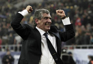Photo - FILE - In this Tuesday, Nov. 19, 2013 file photo, Fernando Santos, the coach of Greece, celebrates after defeating Romania in their World Cup qualifying playoff second leg match at the National Arena in Bucharest. Greece's Football Association said Thursday Feb. 27, 2014, that national coach Fernando Santos will step down following the World Cup in Brazil, after a successful four-year term on the job that saw the country rise to 12th place in the the FIFA world rankings. (AP Photo/Thanassis Stavrakis, File)
