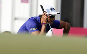 Photo - Rafa Cabrera-Bello of Spain during the third round of the Commercial Bank Qatar Masters at the Doha Golf Club Friday, Jan. 24, 2014. (AP Photo/Osama Faisal)