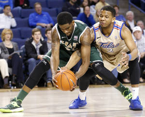 Photo - Tulsa's Pat Swilling Jr., right, tries to get the ball from UAB C.J. Washington during an NCAA college basketball game at the TU Reynolds Center in Tulsa, Okla., Saturday, Jan. 25 ,2014. (AP Photo/Tulsa World,  James Gibbard)  ONLINE OUT; KOTV OUT; KJRH OUT; KTUL OUT; KOKI OUT; KQCW OUT; KDOR OUT; TULSA OUT; TULSA ONLINE OUT