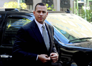 Photo - FILE - In this Oct. 1, 2013, file photo, New York Yankees' Alex Rodriguez arrives at the offices of Major League Baseball in New York, for his grievance hearing. (AP Photo/David Karp, File)