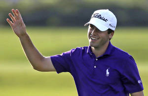 Photo - Ben Martin smiles after a birdie on the 17th hole during the opening round of the PGA Zurich Classic golf tournament at TPC Louisiana in Avondale, La., Thursday, April 24, 2014. Martin shot a course-record 10-under-par 62. (AP Photo/Gerald Herbert)