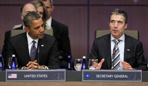 Photo -   President Barack Obama stands looks to NATO Secretary General Anders Fogh Rasmussen during the opening session of the North Atlantic Council at the NATO Summit in Chicago, Sunday, May 20, 2012. (AP Photo/Pablo Martinez Monsivais)