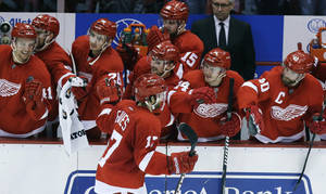 Photo - Detroit Red Wings right wing Patrick Eaves (17) is congratulated by teammates after scoring during the shootout of an NHL hockey game against the Washington Capitals in Detroit, Friday, Jan. 31, 2014. The Red Wings won 4-3. (AP Photo/Carlos Osorio)