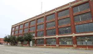 Photo -  The former Fred Jones assembly plant in the 900 block of W Main is set to be converted into a 21C Museum Hotel. PHOTO BY PAUL B. SOUTHERLAND, THE OKLAHOMAN  <strong>PAUL B. SOUTHERLAND -   </strong>