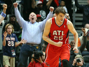 Photo - Atlanta Hawks guard Kyle Korver (26) celebrates his 3-pointer that put the Hawks in the lead over the Miami Heat during the second half of an NBA basketball game on Monday, Jan. 20, 2014, in Atlanta. (AP Photo/Atlanta Journal-Constitution, Curtis Compton)