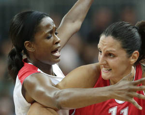 Photo -   United States forward Swin Cash, left, traps Croatia forward Ana Lelas while looking to passbasketball game at the 2012 Summer Olympics, Saturday, July 28, 2012, in London. (AP Photo/Charles Krupa)